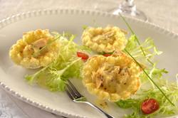 Conchas con pescado en salsa bechamel y borde de papa-Corregido
