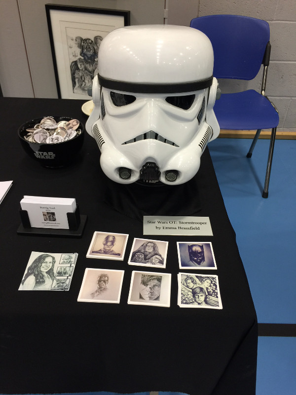IGABFAT:  Custom trooper helmet as constructed by Emma Brassfield, along with some badges and a set of small square prints.