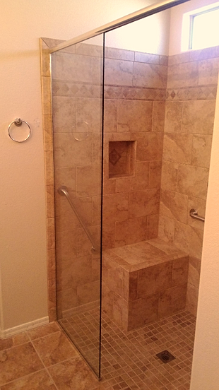 frameless glass shower doors that open in either direction are a modern alternative to a shower curtain or framed door