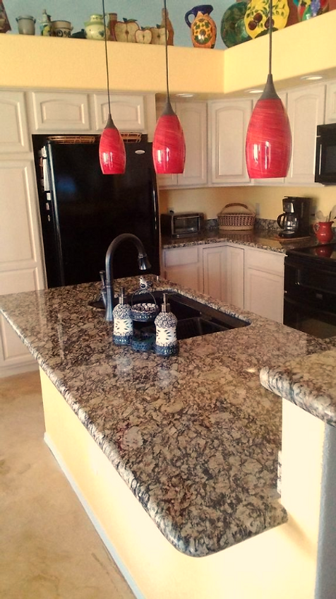 Red Pendant Lighting Is A Vibrant, Trendy Addition To This Kitchen. The Giallo  Portofino Granite Countertops Are Sleek And Classic.