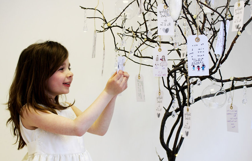A bridesmaid reading the guest wishing tags