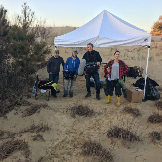 Crew (from left to right): Ryan Hamlin, Paul Frateschi, Aaron Bittikofer, and Caitlin Wells at Jockey's Ridge. Photo by Kieran Moreira