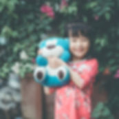 Girl with teddybear.