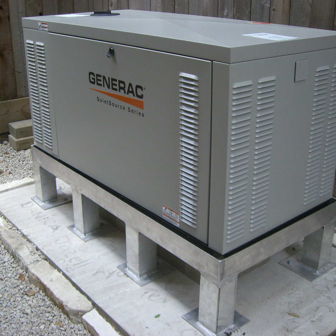 Emergency generator affixed to steel stand in flood-prone area.