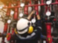 maintenance man repairing the pipe of fi