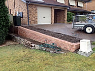Brick retaining wall installed to engineers specifications provide a long lasting solution with beautiful range of brick finishes.
