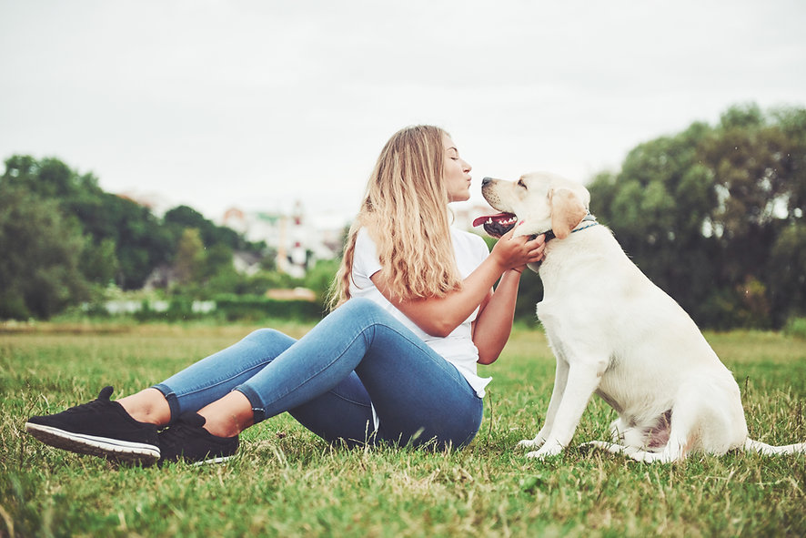 young-woman-with-labrador-outdoors-woman