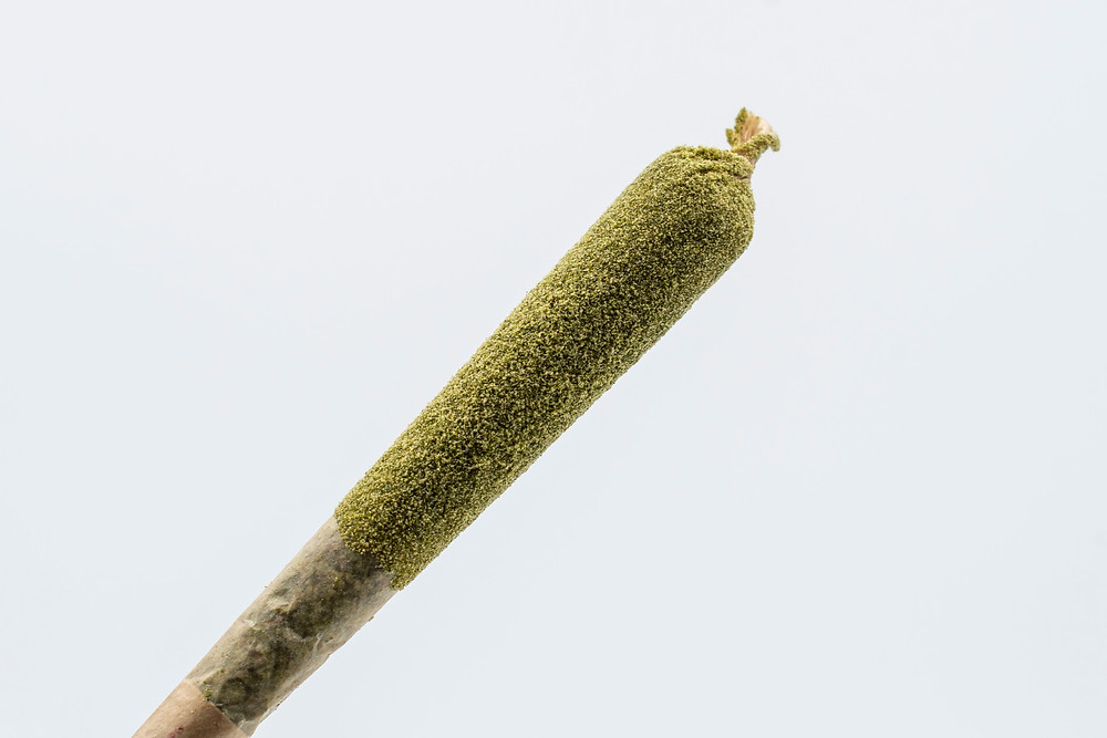 joint dipped in hash oil and kief by the epic remedy