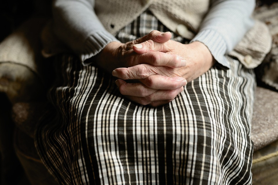 Elderly Woman with hands folded - LogicMark PERS