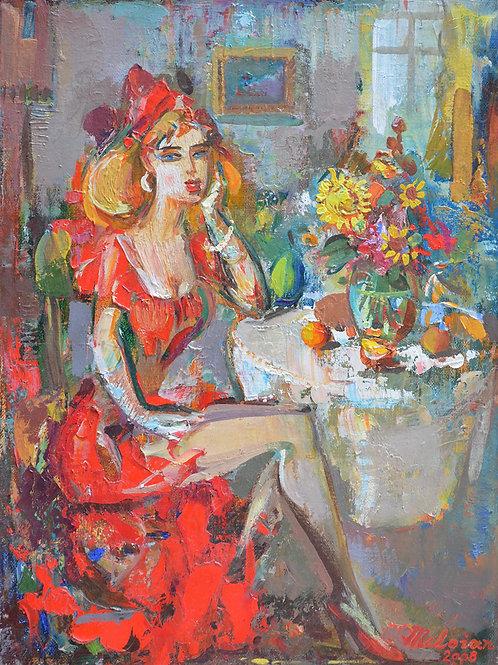 Женщина за столиком