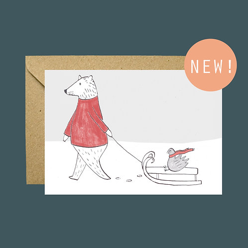 Bear pulling sled winter greetings card