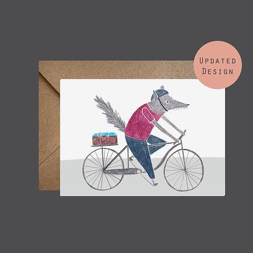 Wolf riding a bike greetings card