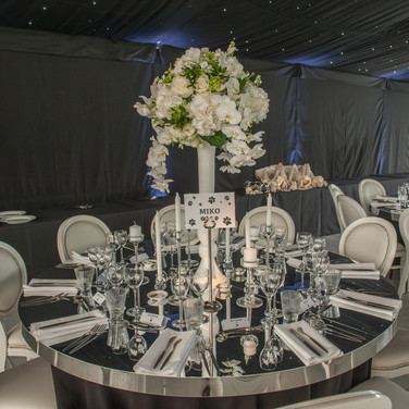 Mirror Tables and White Flowers
