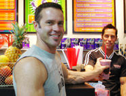 Man with protein smoothie in cafe