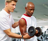Man working out with a personal trainer