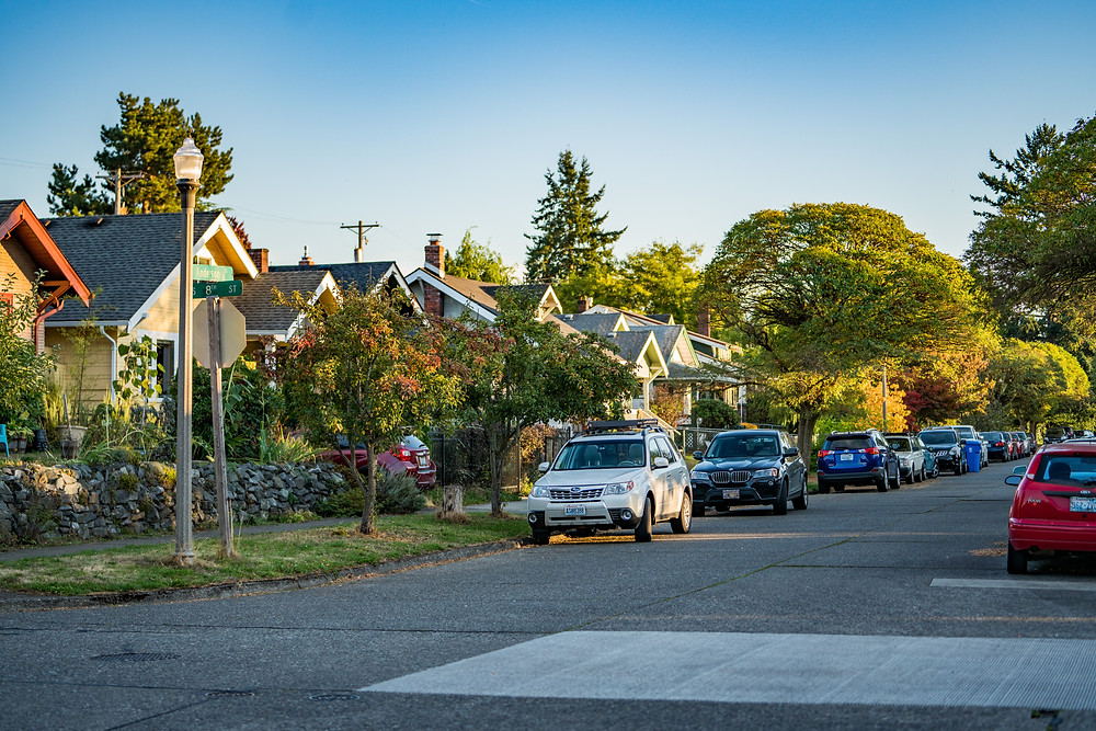View from 8th Street, tree lined street with homes and cars parked along street