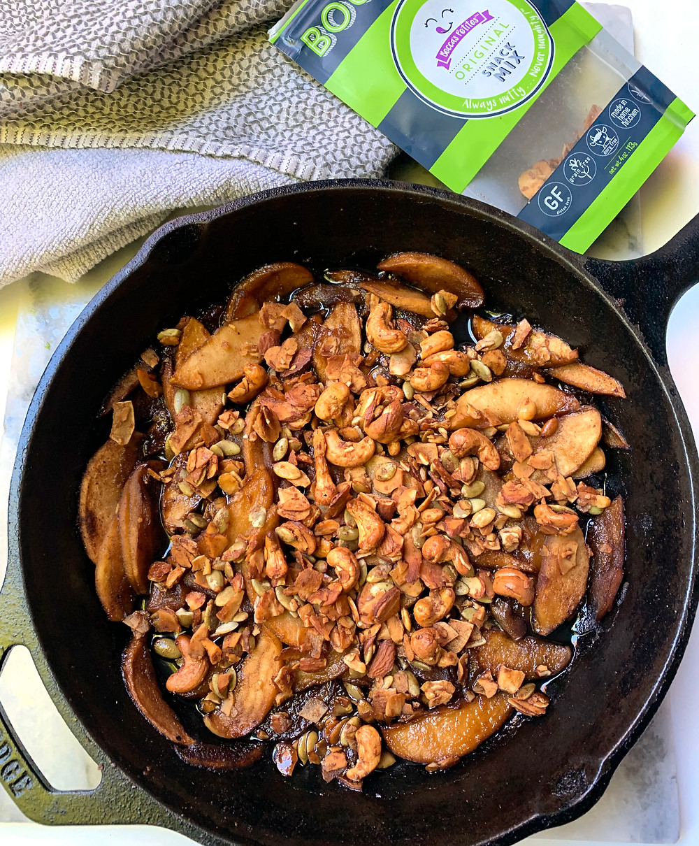 Grain Free Apple Crumble Recipe in a cast iron skillet made with our shops product Becca's Petites snack mix.