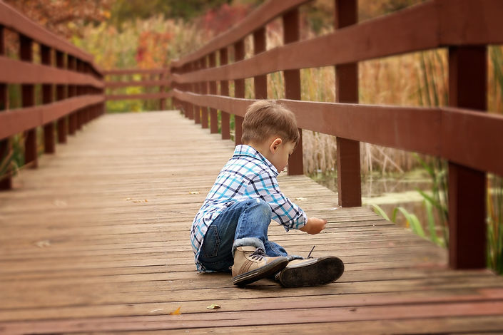 boy by self on bridge.jpeg