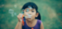 girl blowing bubbles.jpeg