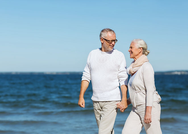 Mature couple walking along the beach
