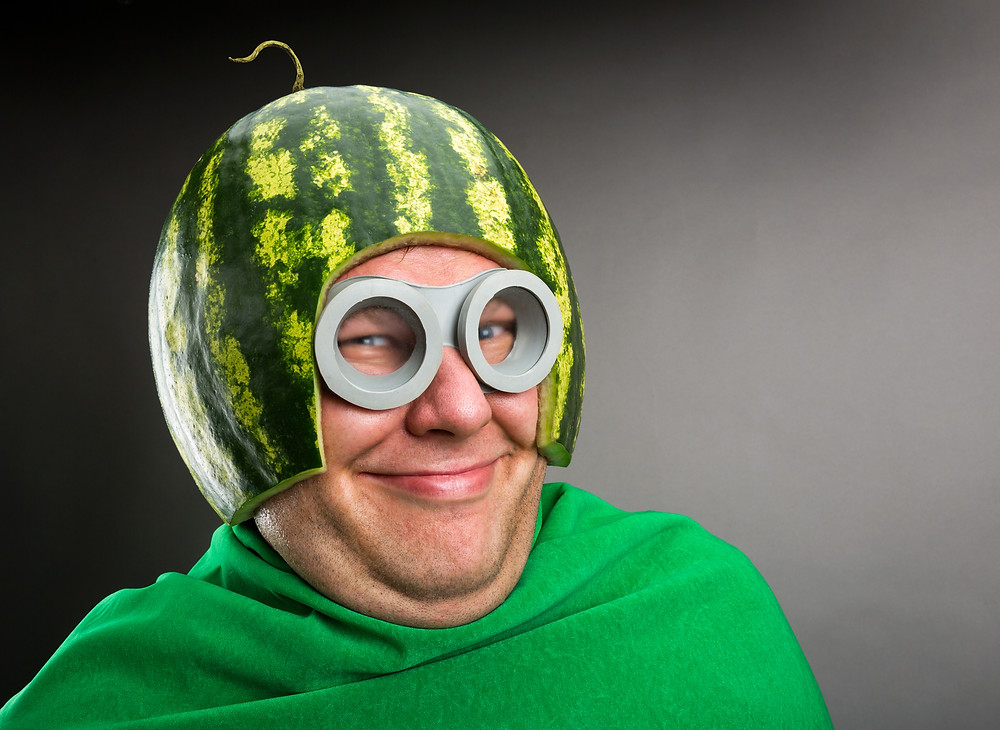 Man with a a melon on his head