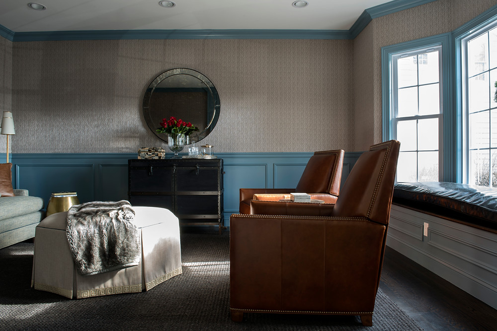 living room with blue wainscot