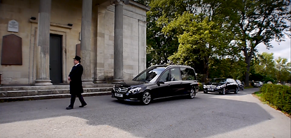 Funeral Director leads a hearse