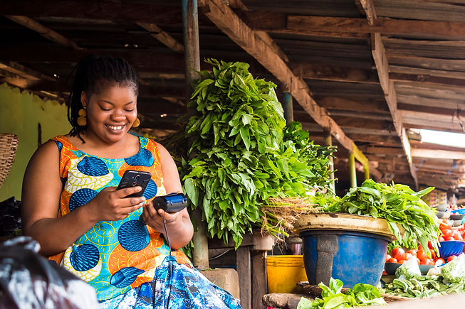 african woman using her phone and also h
