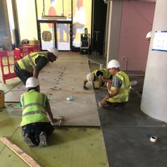 Floor Tiles being installed