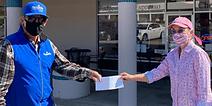 Melissa Arias accepts grant award from Tom Long, Pajarito Ski Area general manager