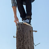 Man with Snickers on top of a Tree Stump