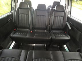 Conference seating in our luxury Mercedes Viano creates a spacious and social environment.  A further seat is available alongside the driver.  Tinted windows provide additional privacy and comfort.  The rear luggage area is enormous.