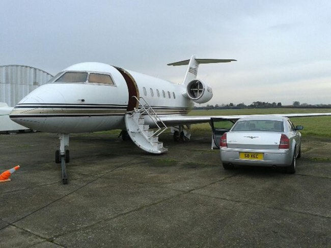 Select Chauffeurs Chrysler 300C alongside private jet