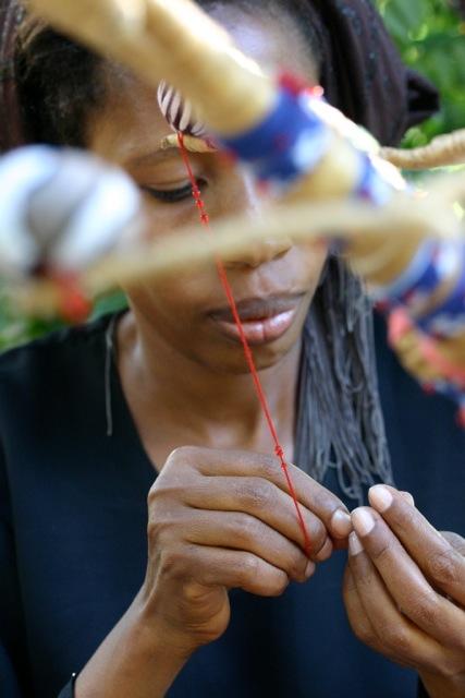 Sewing tassels at Moyo Designs in Tanzania