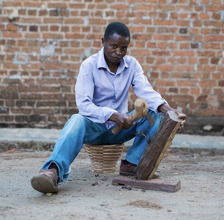 Carving mahogany for Blantyre Jar lids at People of the Sun in Malawi
