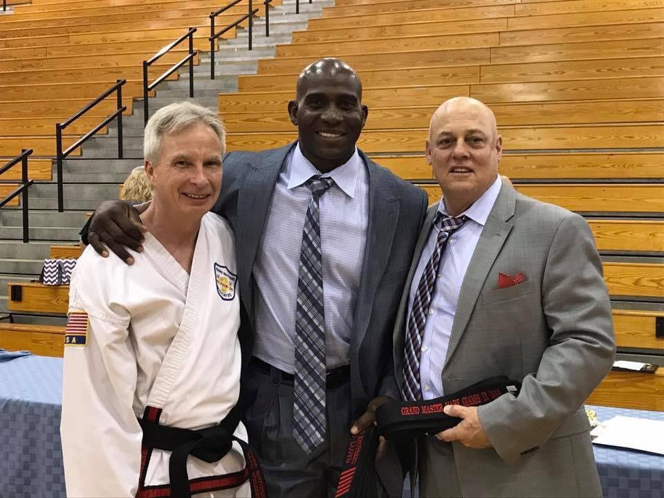 Grand Master McCloskey, Master Greg Lloyd, and Grand Master Giambi