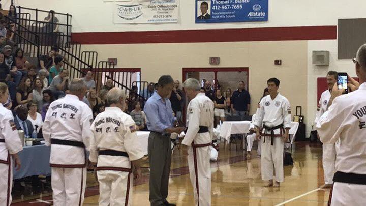 Grand Master Young Bo Kong presenting an 8th Dan to Grand Master McCloskey