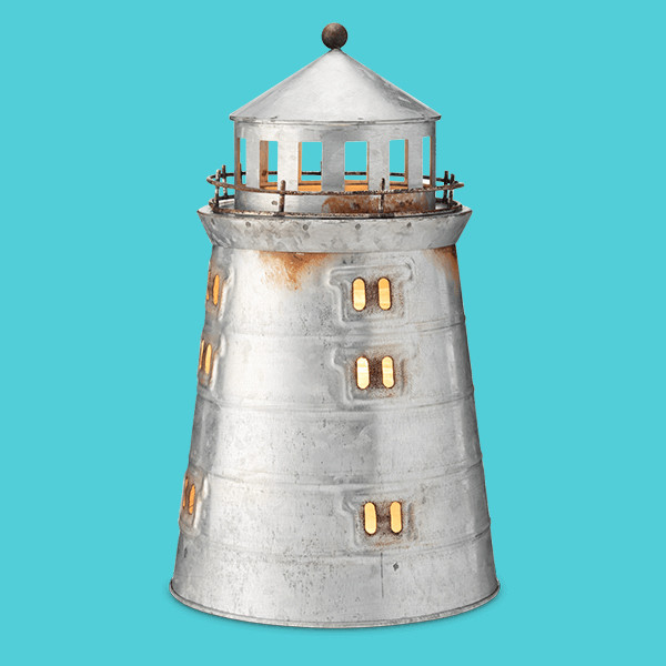 Reminiscent of the most photographed lighthouse in the world, the Portland Warmer takes you to a peaceful Maine shoreline. Featuring handcrafted galvanized steel,  cut-out windows and a misty glow, it alludes  to a steady beacon of hope in the distance.