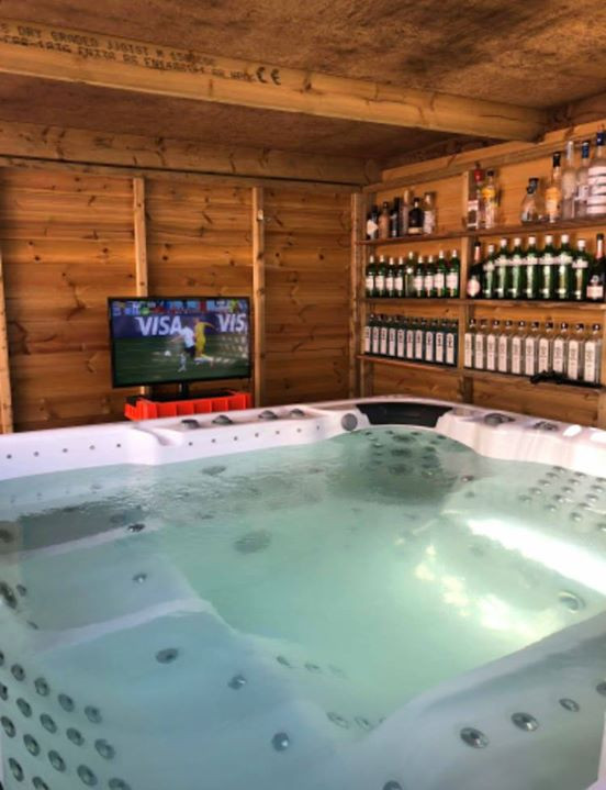 Hot tub with bar and TV