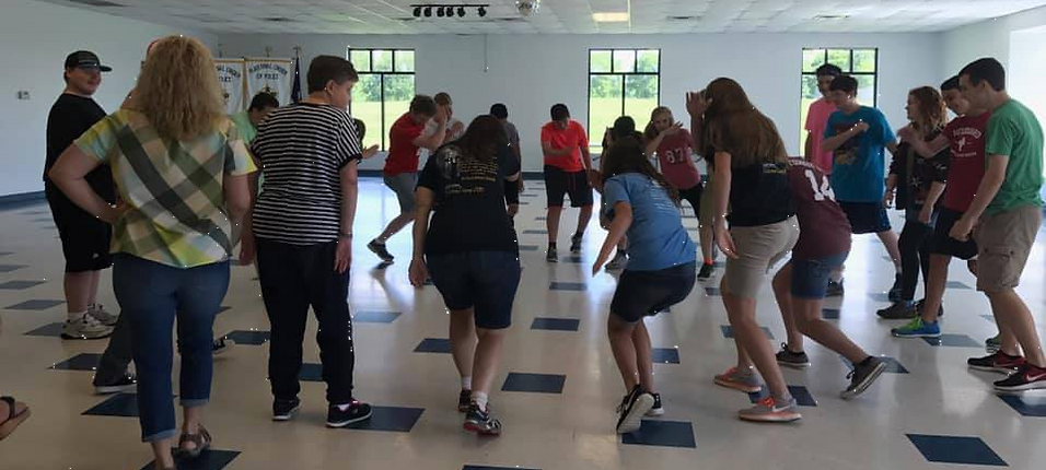 HIVE members dancing in a circle