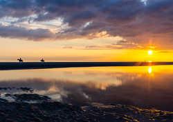 Sunset on the beach in Zeeland, The Neth