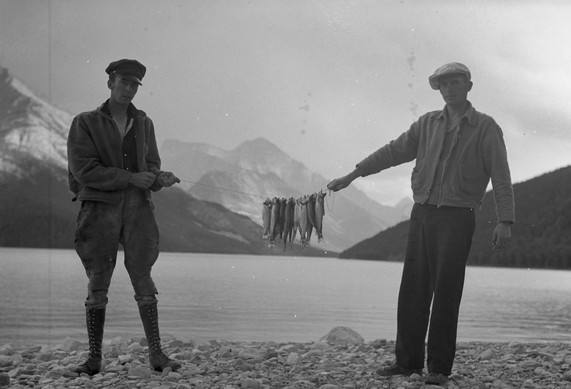 Forest fire Cameron Lake Waterton two men with fish - GUSHUL