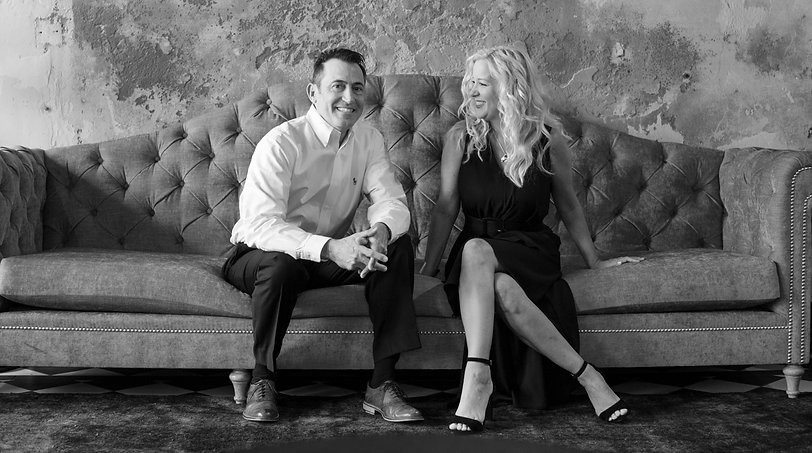 Social media managers Robert Rhoden and Sheri Sable-Campbell, of Sable-Rhoden Media, share a laugh in New Orleans.