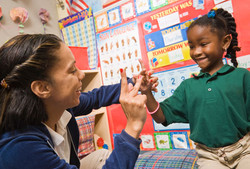 getty_rm_photo_of_girl_learning_sign_language.jpg