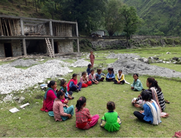 Teacher teaching outside the scholl during her mentruation period before the Chhaupadi campaigning.
