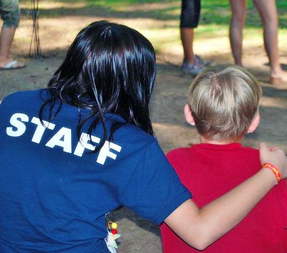 Staff arm around camper.jpg