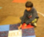 boy working on quilt.jpg