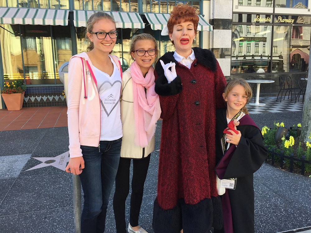 My sisters and I with Lucy at Universal Studios on our Daytona Race Trip