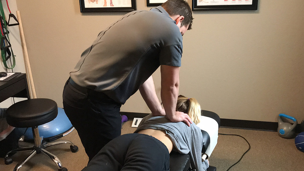 Haylee being treated by Corey O'Neil at Pro Spine and Sport