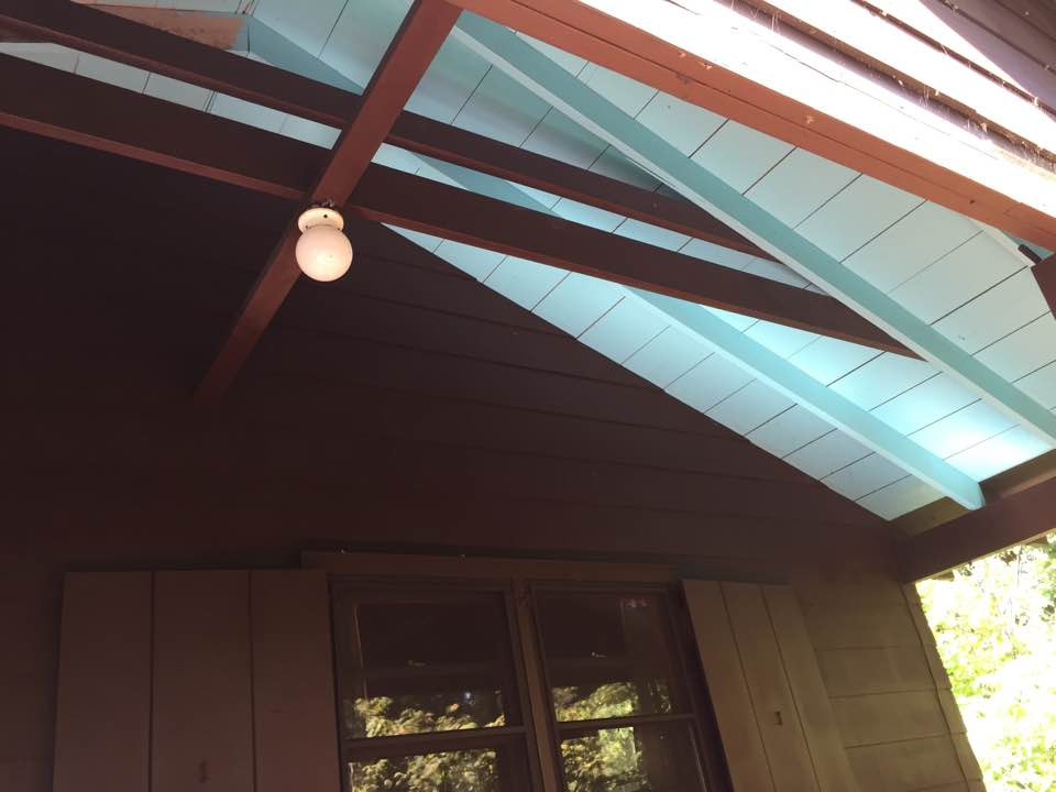 My ma, dad and I painted the ceiling of the Anchorage porch.  It was horrible. SO many spiders!